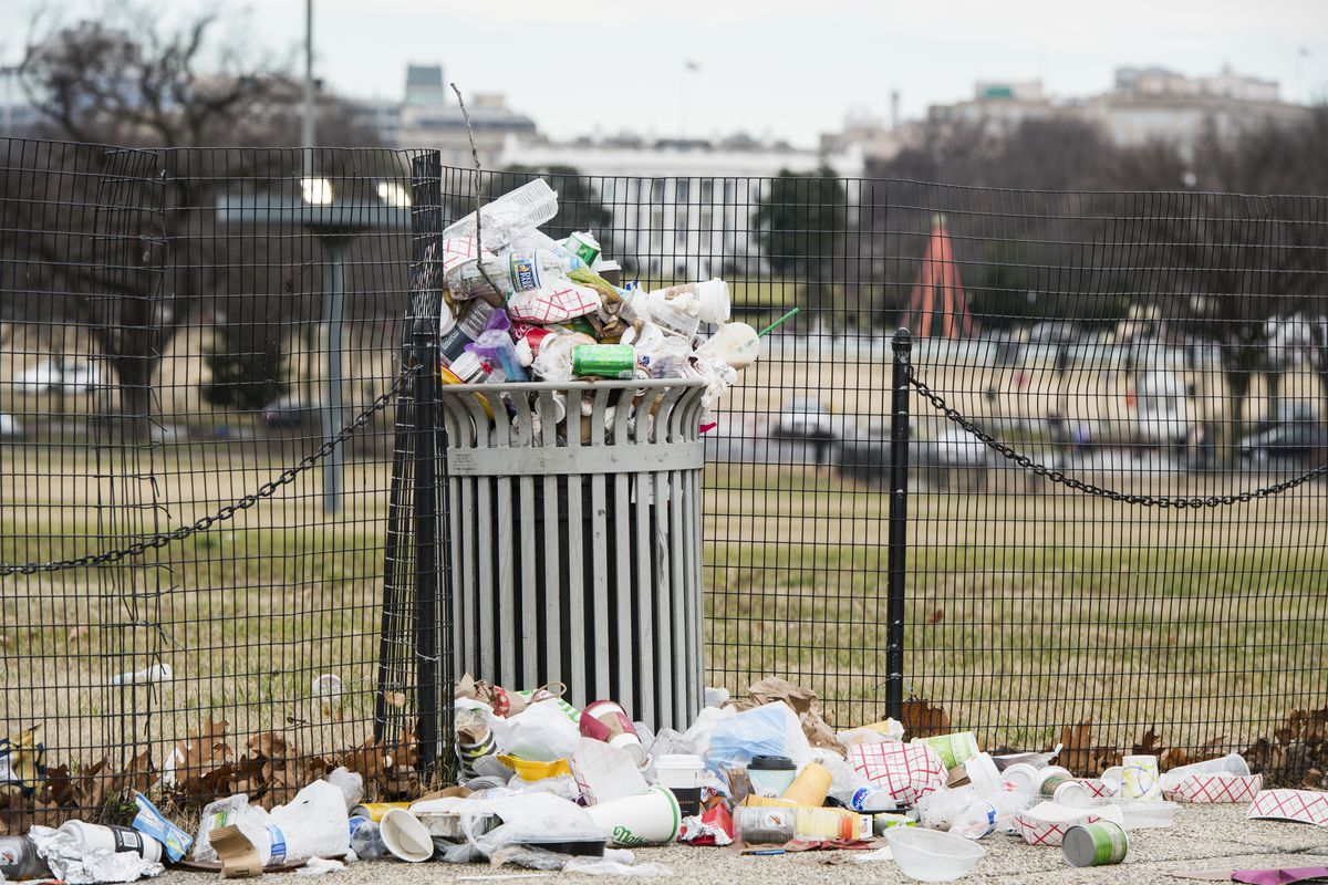 Garbage overflows a trash can on the National Mall across from the White House on Tuesday, Jan. 1, 2019. The National Park Service, which is responsible for trash removal, is not operating due to the goverment shutdown.