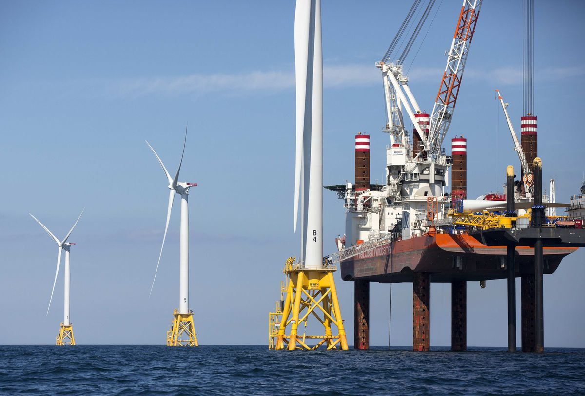 A lift boat (right) that serves as a work platform is used to assemble a wind turbine off Block Island, R.I.