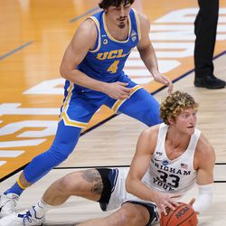 BYU forward Caleb Lohner (33) looks for help as UCLA guard Jaime Jaquez Jr. (4) closes in during the first half of a first-round game in the NCAA college basketball tournament at Hinkle Fieldhouse in Indianapolis, Saturday, March 20, 2021.
