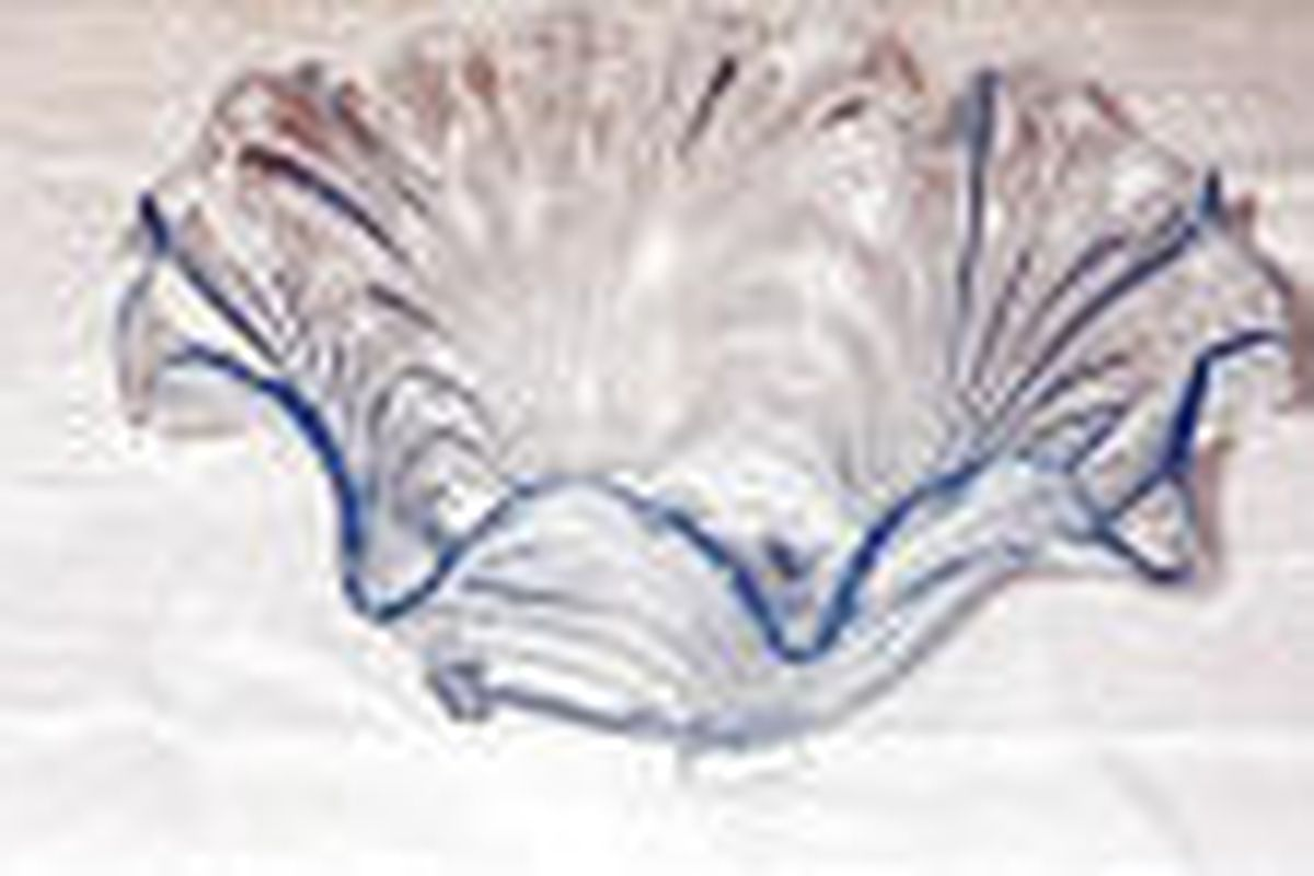 A.A.'s pressed glassware, in a pattern called Caprice, originated in the 1940s and reportedly was made by Cambridge Glass Co. until 1957 or so.