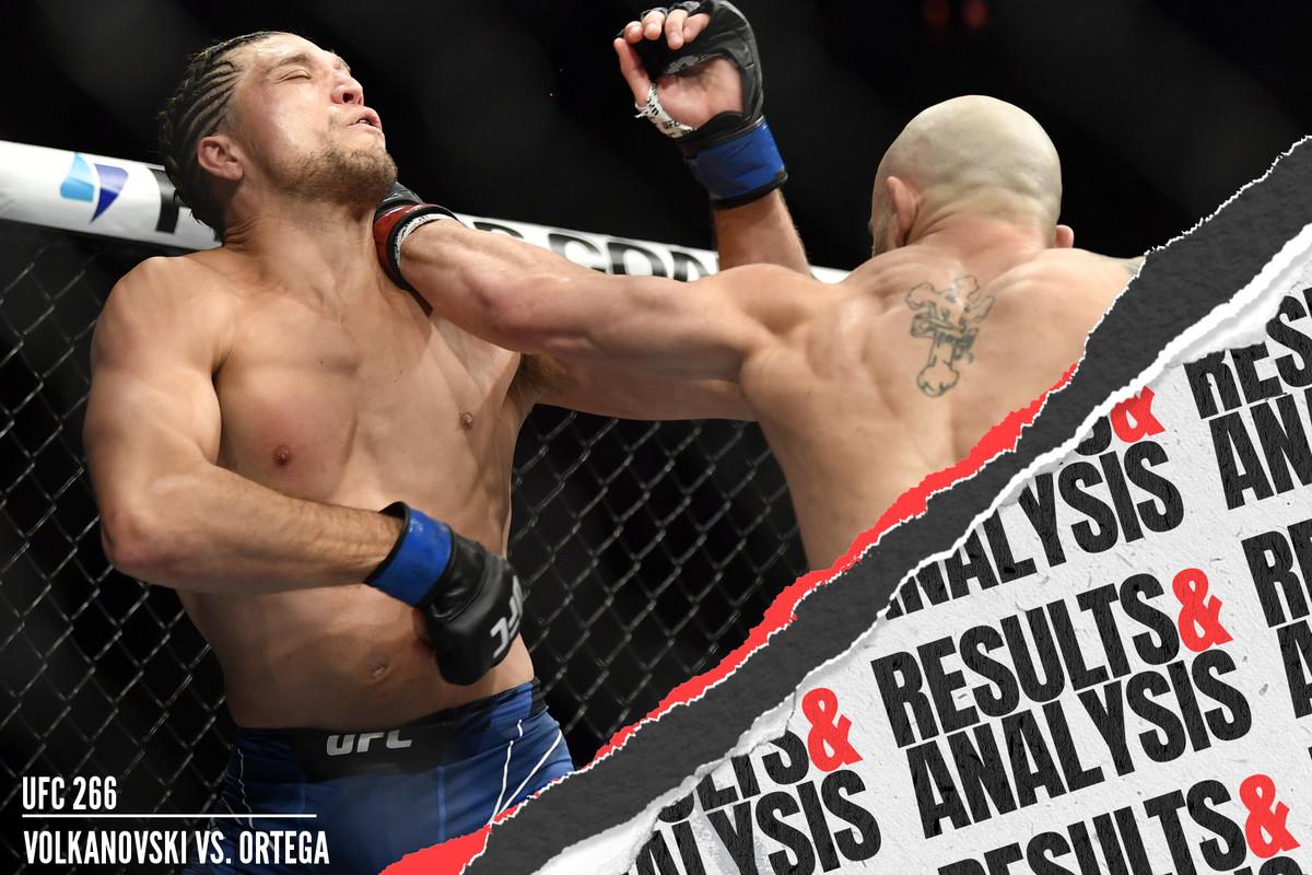 Alexander Volkanovski punches Brian Ortega in their UFC 266 main event.