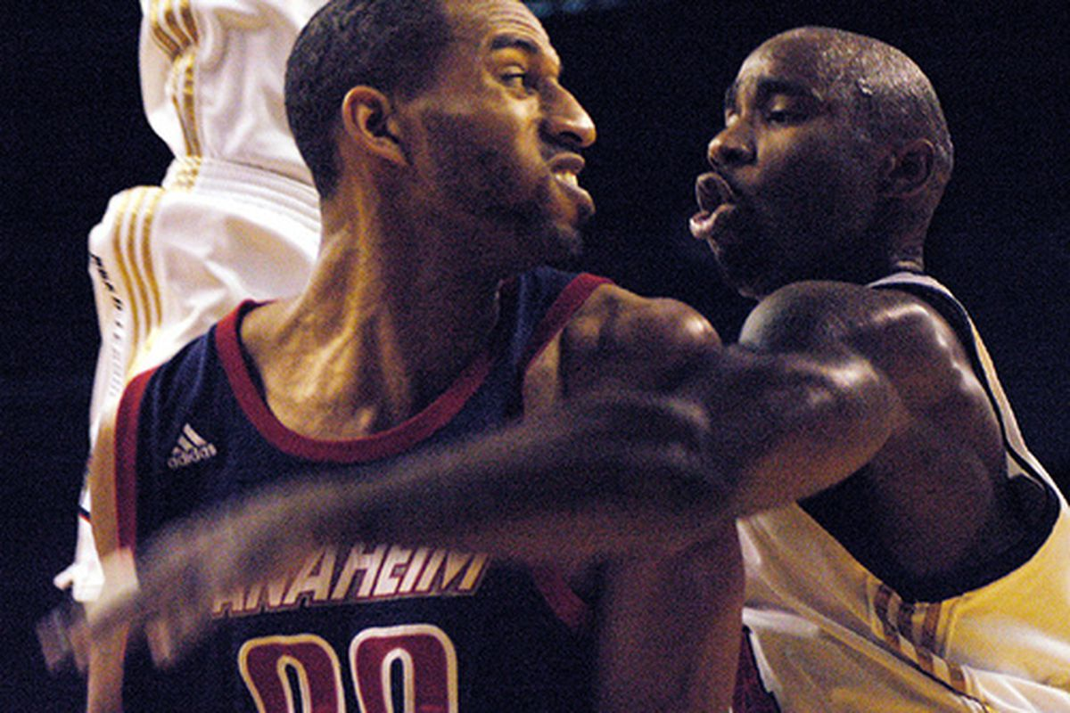 """Mateen Cleaves (right) and Cedric Bozeman fight for the ball while making awkward faces at one another.  Photo courtesy of <a href=""""http://www.facebakersfield.com/?p=6270"""" target=""""new"""">Face Bakersfield</a>."""