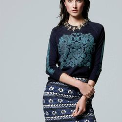 Embossed floral sweater and floral jacquard mini skirt.