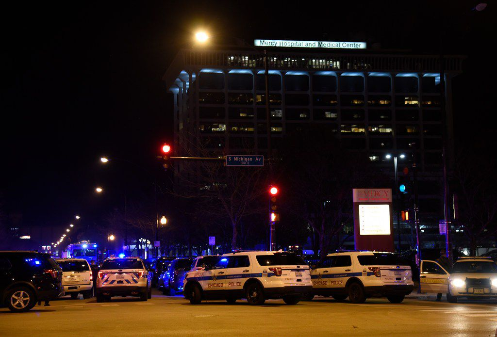 Chicago Police work the scene where a gunman opened fire at Mercy Hospital. AP Photo/David Banks