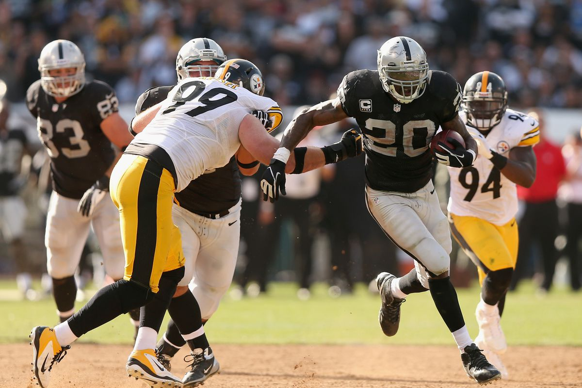 Darren McFadden #20 of the Oakland Raiders runs with the ball against the Pittsburgh Steelers