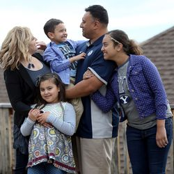 Timberly, Sadie, KK, Kalani and Skye Sitake at home in Provo on Friday, March 11, 2016.