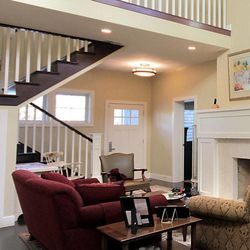 The addition of the stairs helped to define the transition space while keeping the ceiling low above the entry made it more comfortable and inviting.