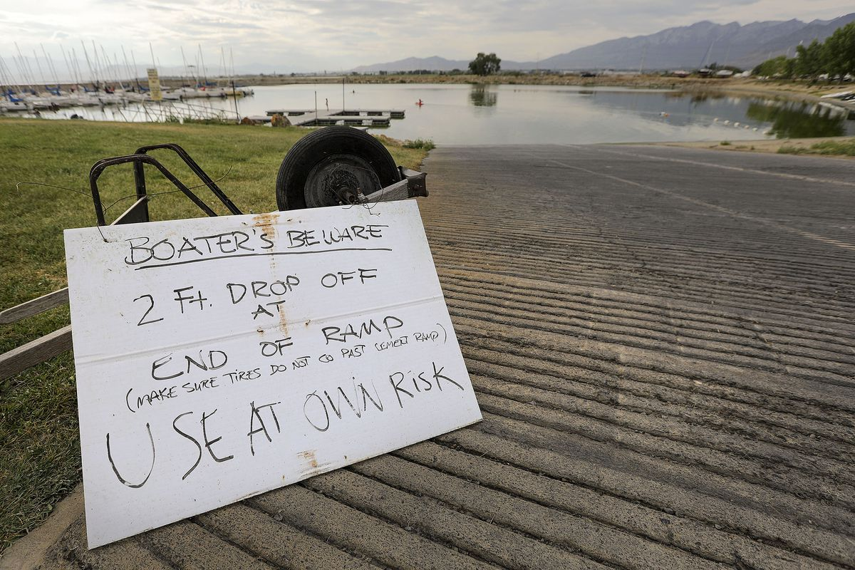 A sign warns sailors of low water and a boat ramp a sharp drop-off at Lyndon Marina in the Vineyard on Monday, July 19, 2021.