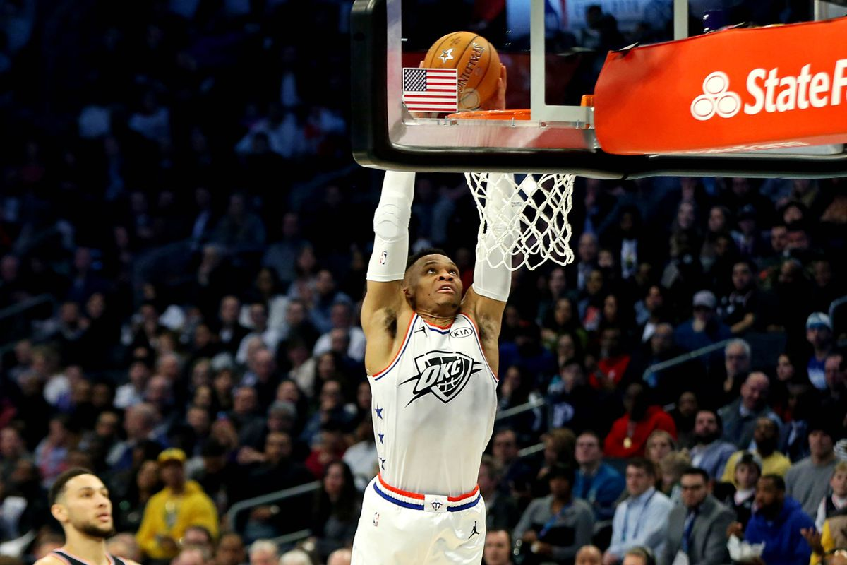 Team Giannis guard Russell Westbrook of the Oklahoma City Thunder dunks the ball against Team LeBron guard Ben Simmons of the Philadelphia 76ers during the 2019 NBA All-Star Game at Spectrum Center.