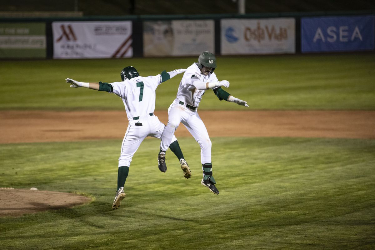 Utah Valley's Mick Madsen, left, and Pacen Hayes leap in celebration after Hayes delivered the walk-off hit for the Wolverines in Friday's series opener against Chicago State at UCCU Ballpark in Orem.