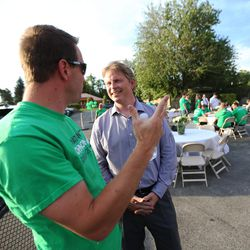 Emron Andrew talks with Jonathan Johnson at a party at the Johnson headquarters on Tuesday, June 28, 2016. Johnson lost his primary challenge to Gov. Gary Herbert.