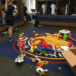 Amy Rodriguez's two boys — Luke and Ryan — made the Royals' locker room their own during a recent practice.