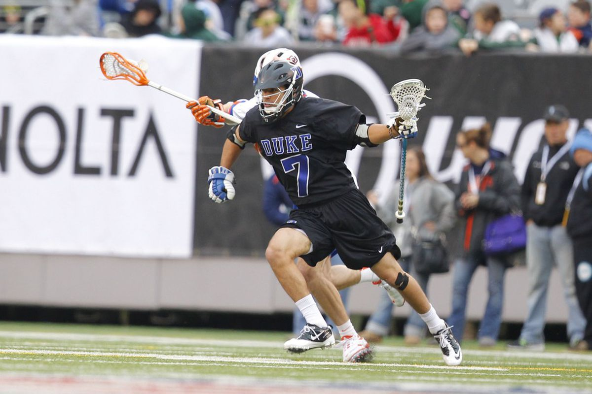 Apr 1, 2012; East Rutherford, NJ, USA;  Duke Blue Devils midfielder Jake Tripucka (7) brings the ball up field against the Syracuse Orange at the Big City Classic at MetLife Stadium. Mandatory Credit: Jim O'Connor-US PRESSWIRE
