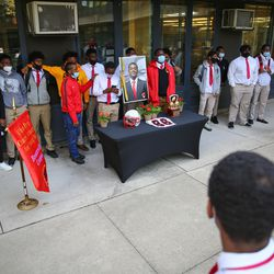 Classmates and Football team members take photos next to small memorial for Rashad Verner at Urban Prep Academy High School Bronzeville Campus at 521 E 35th St in Ida B. Wells / Darrow Homes Tuesday, Oct. 6, 2020.