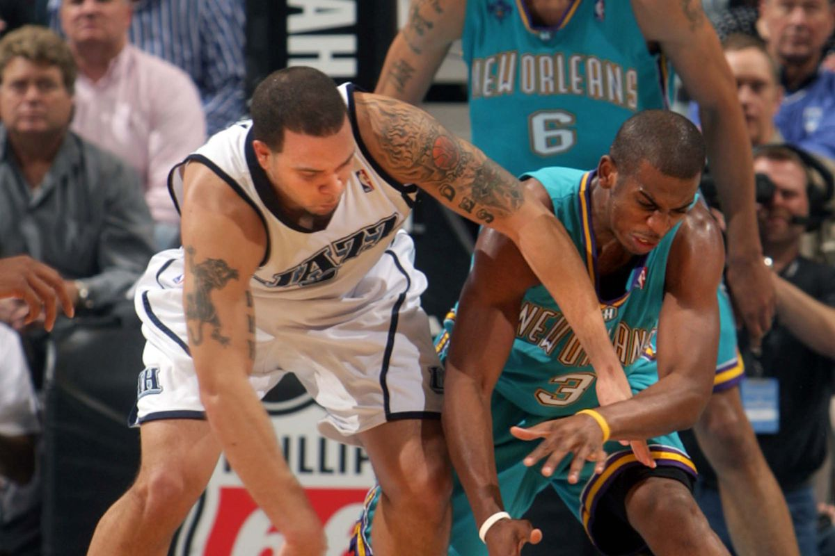 Former Utah Jazz guard Deron Williams and former New Orleans Hornets guard Chris Paul go after a loose ball.
