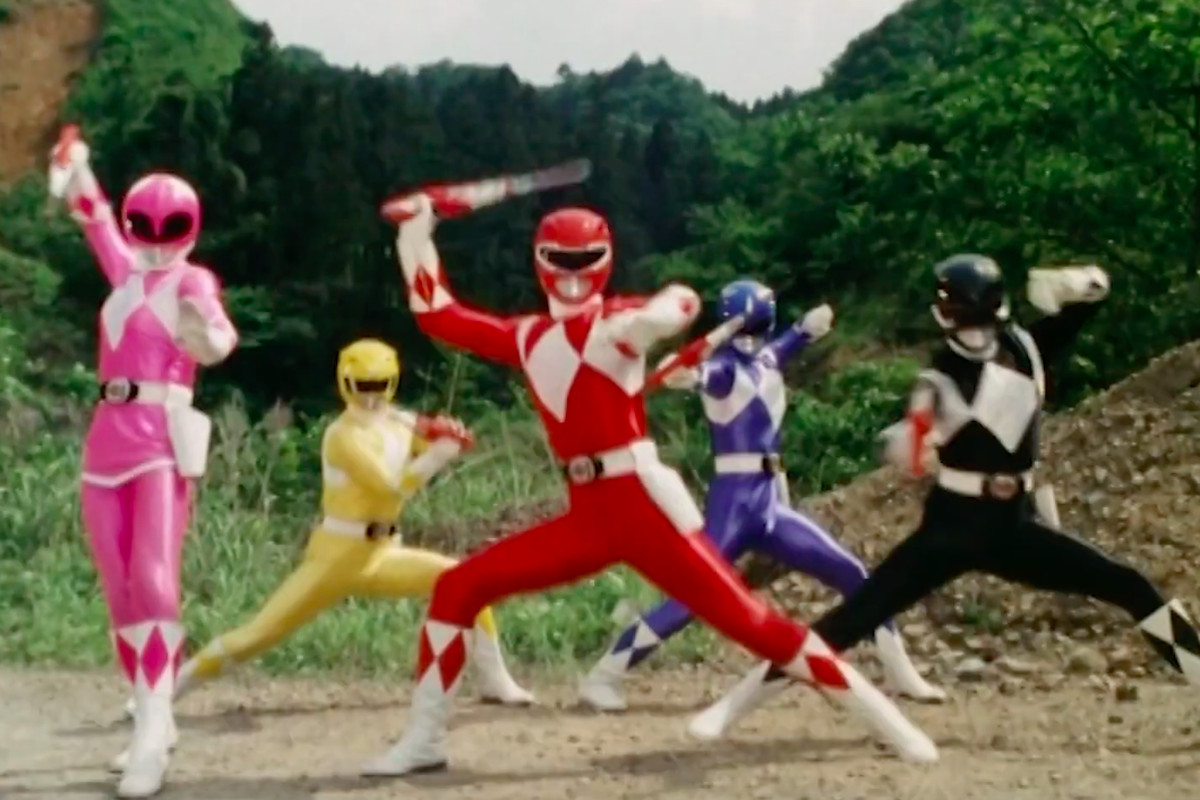A group of super sentai rangers stand in battle pose