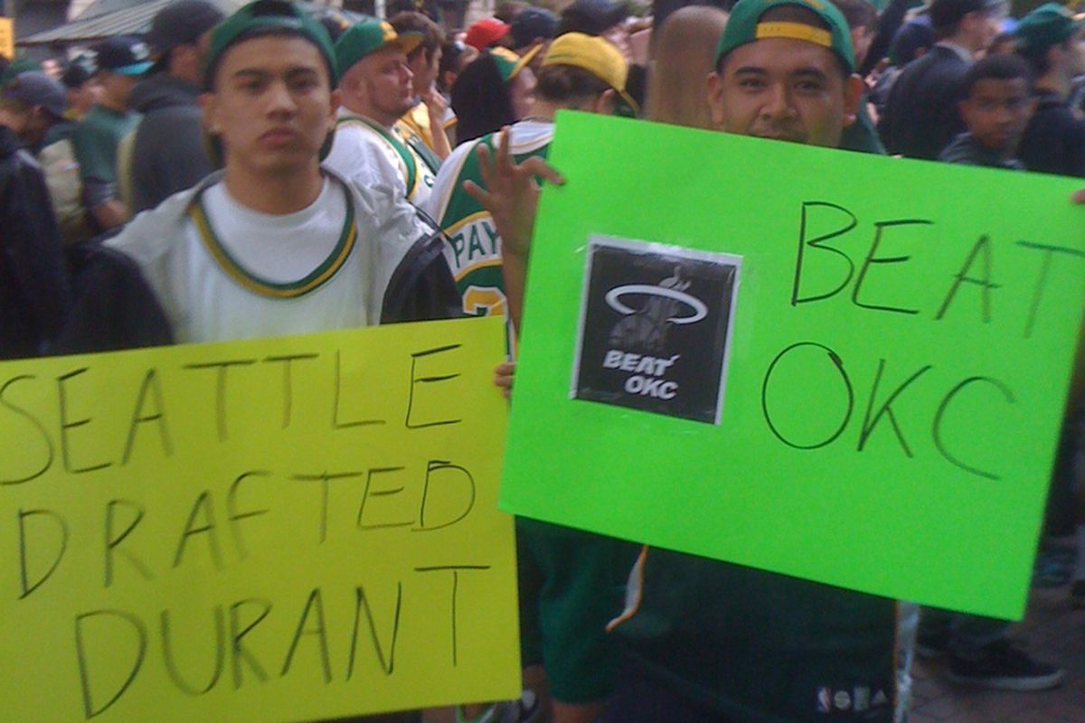 Several Sonics fans brought signs to raise at Thursday's rally at Occidental Park.