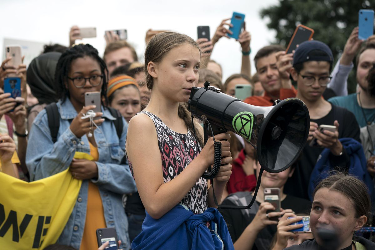 Swedish climate activist Greta Thunberg, 16, uses a bullhorn to speak to a crowd.