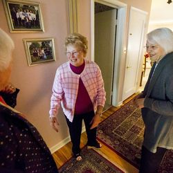 Former Utah First Lady Norma Matheson, right, greets friends Lynda Fletcher and Carol McFarland, center, as she meets with a group of friends for their monthly book club on Thursday, April 20, 2017.