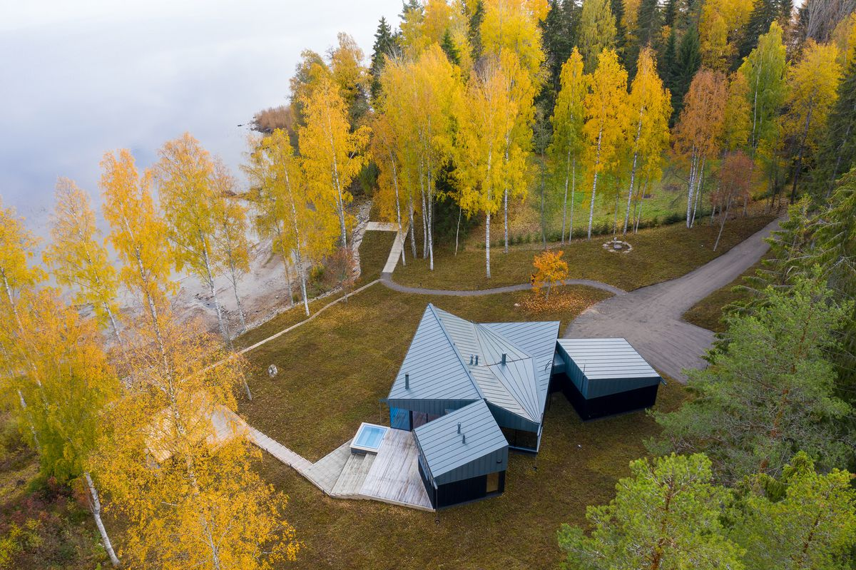 Aerial shot of modern house in forest.