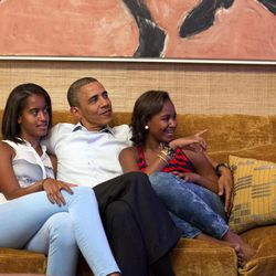 In this image released by the White House, President Barack Obama and his daughters, Malia, left, and Sasha, watch first lady Michelle Obama speak at the Democratic National Convention on television from the Treaty Room of the White House Tuesday, Sept. 4, 2012.