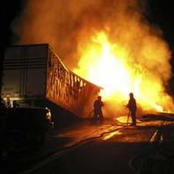 The trucks' tanks initially fueled the blaze, but the flammable cargo of paper and wood kept the fire going.