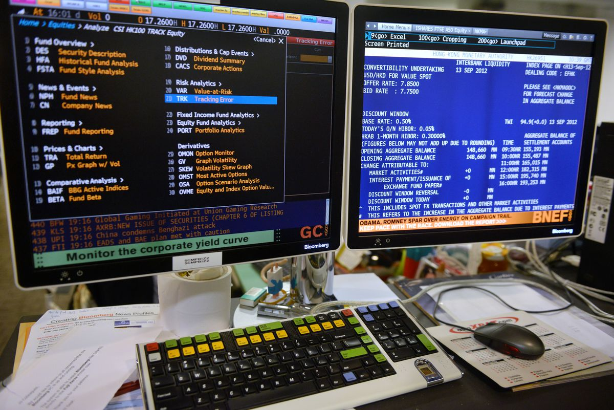 Two monitors showing the Bloomberg Terminal screen.