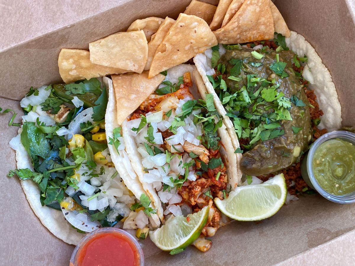 A photo of the vegetable, cauliflower, and soyrizo tacos from Tight Tacos in a takeout box