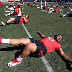 Utah Utes offensive lineman Salesi Uhatafe (74) warms up with the Utes before playing the California Golden Bears in a football game at the California Memorial Stadium in Berkeley, California, on Saturday, Oct. 1, 2016.