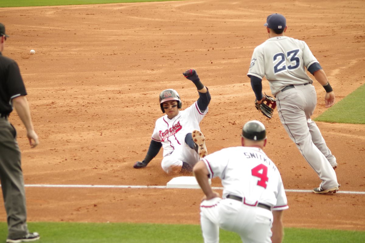 Rio Ruiz slides into 3rd base after his 2nd inning triple