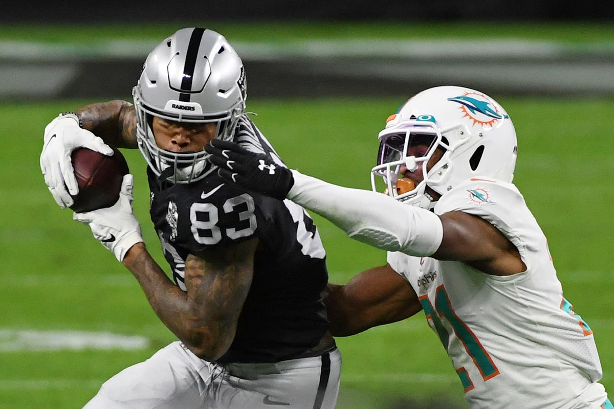 Darren Waller #83 of the Las Vegas Raiders makes a catch against free safety Eric Rowe #21 of the Miami Dolphins in the first half of their game at Allegiant Stadium on December 26, 2020 in Las Vegas, Nevada. The Dolphins defeated the Raiders 26-25.
