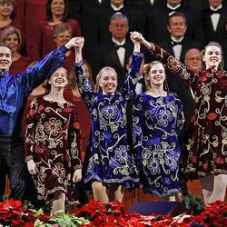 Dancers perform along with the Mormon Tabernacle Choir at the annual Christmas concert at the Conference Center.