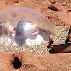 Visitors get a close-up view of residents of the prairie dog village at South Dakota's Reptile Gardens.