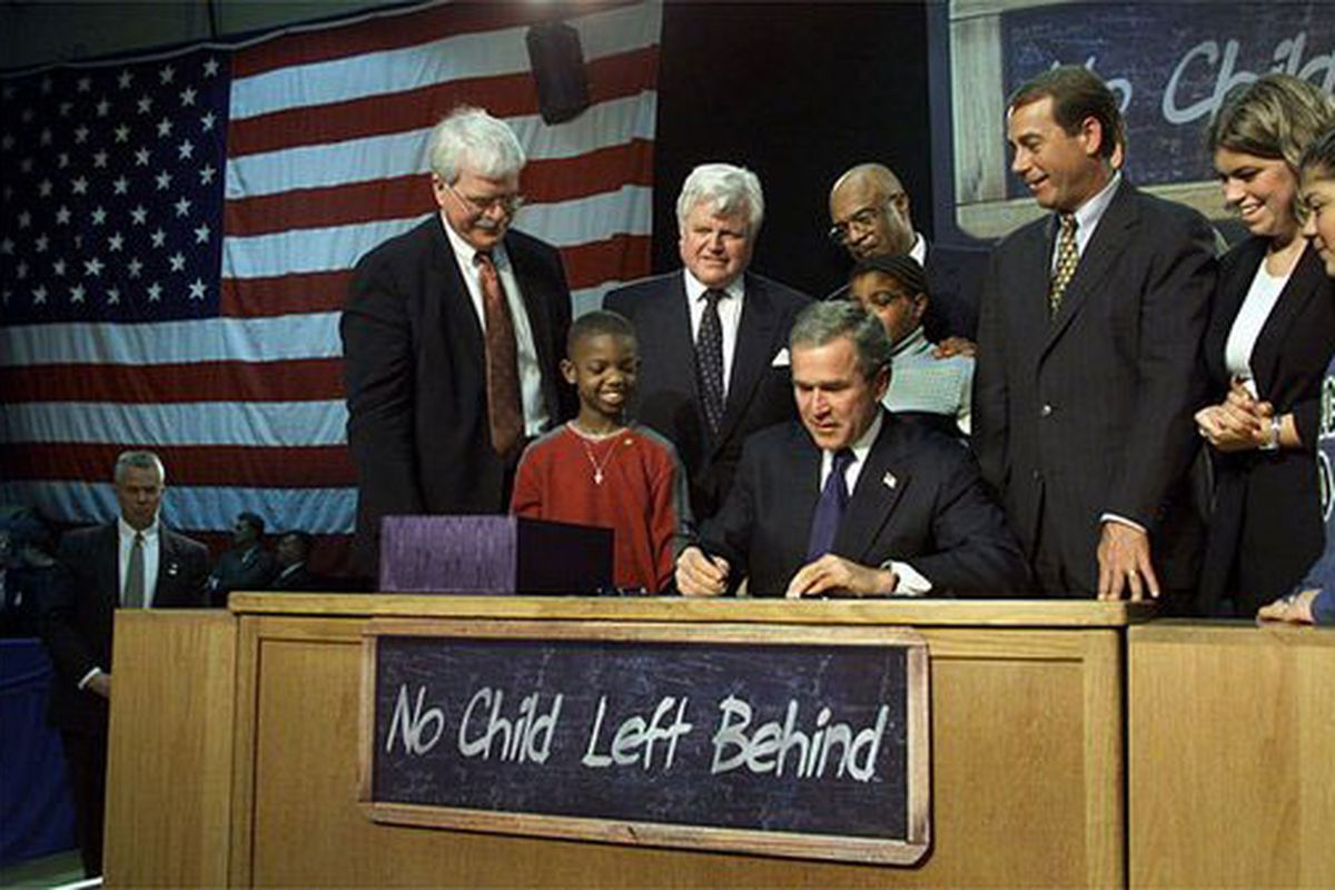 President George W. Bush signs into law the No Child Left Behind Act on Jan. 8, 2002 at Hamilton High School in Hamilton, Ohio.