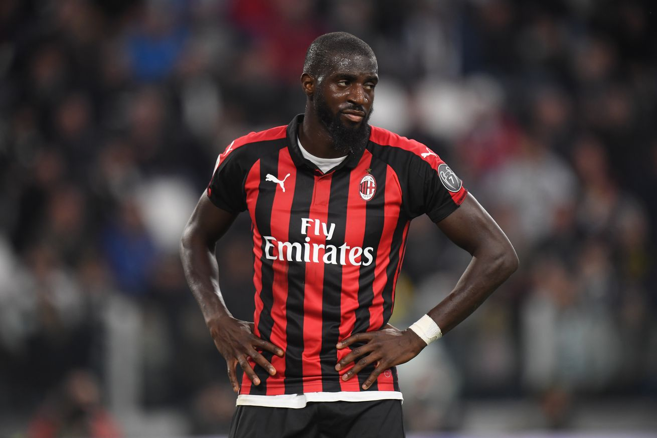 AC Milan?s Bakayoko holds up the jersey of Lazio defender Acerbi and sets the world on fire