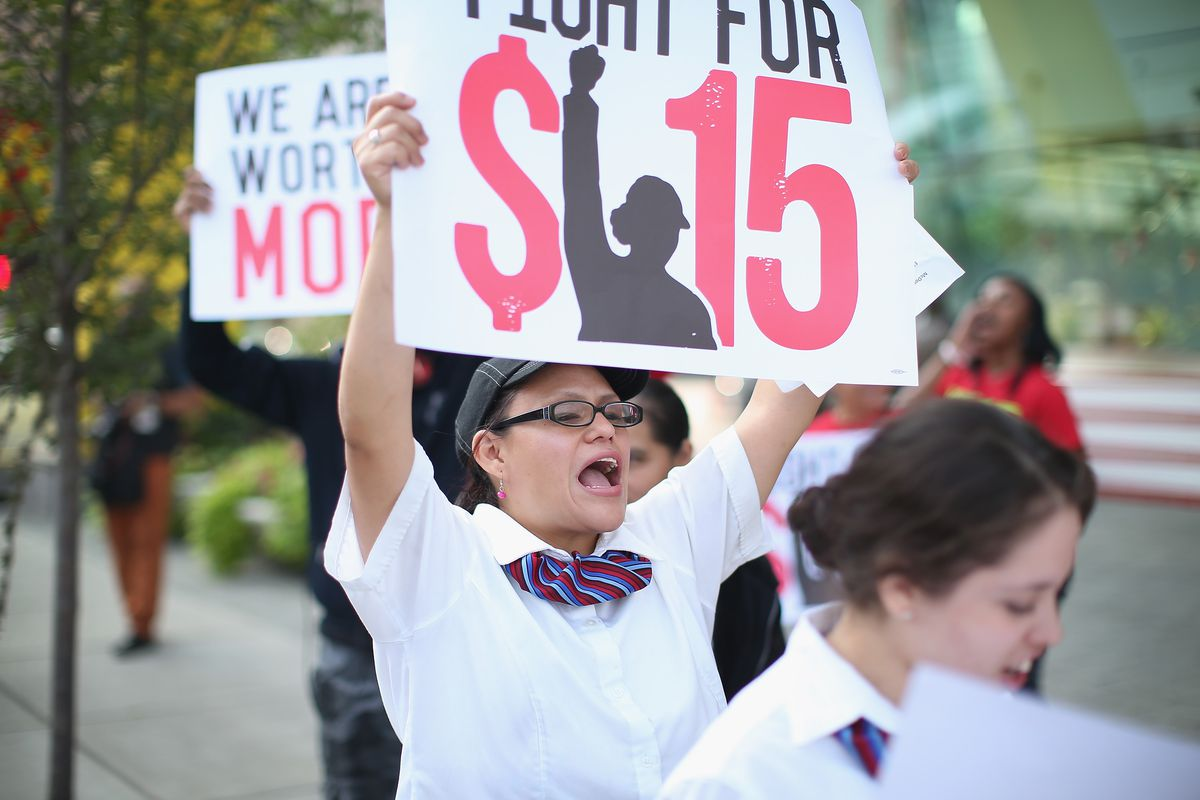 A Chicago fast-food workers protests for a $15 minimum hourly wage