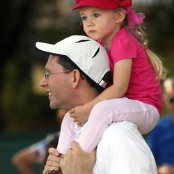 LeDawn Erickson watches the Days of '47 Youth Parade on her father Mike Erickson's shoulders in Salt Lake City on Saturday, July 20, 2013.