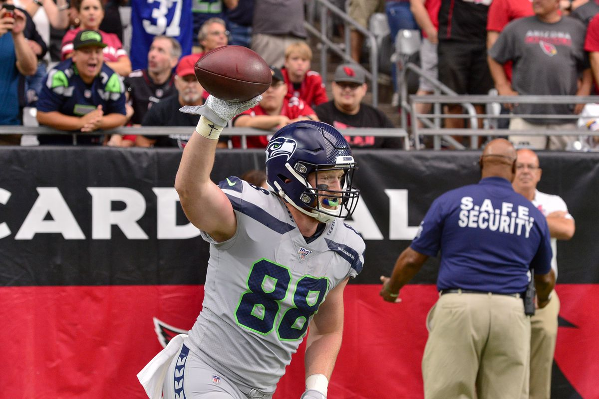 Seattle Seahawks tight end Will Dissly celebrates after catching a touchdown in the first half against the Arizona Cardinals at State Farm Stadium.