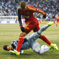Real's Alvaro Saborio runs over Kansas City's Benny Feilhaber as Real Salt Lake and Sporting KC play Saturday, Dec. 7, 2013 in MLS Cup action.