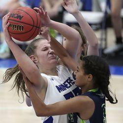 Bingham's Lauren Yeschick and Ridgeline's Nia Damuni fight for the ball during a girls basketball game at Bingham High School in South Jordan on Friday, Dec. 4, 2020. Bingham won 37-32