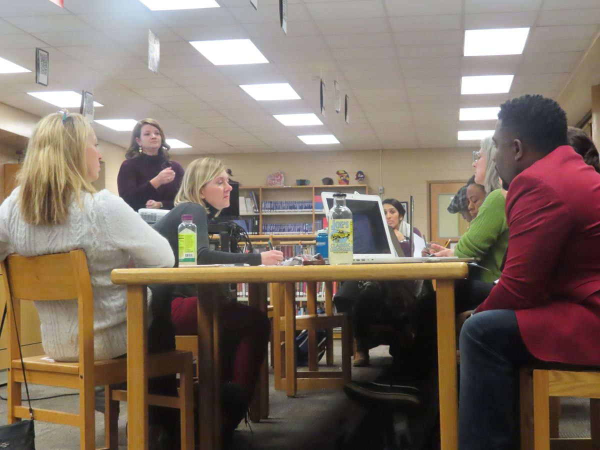 Former Acting Principal Rebecca Bancroft (standing) leads a January LSC meeting at Ogden International School.