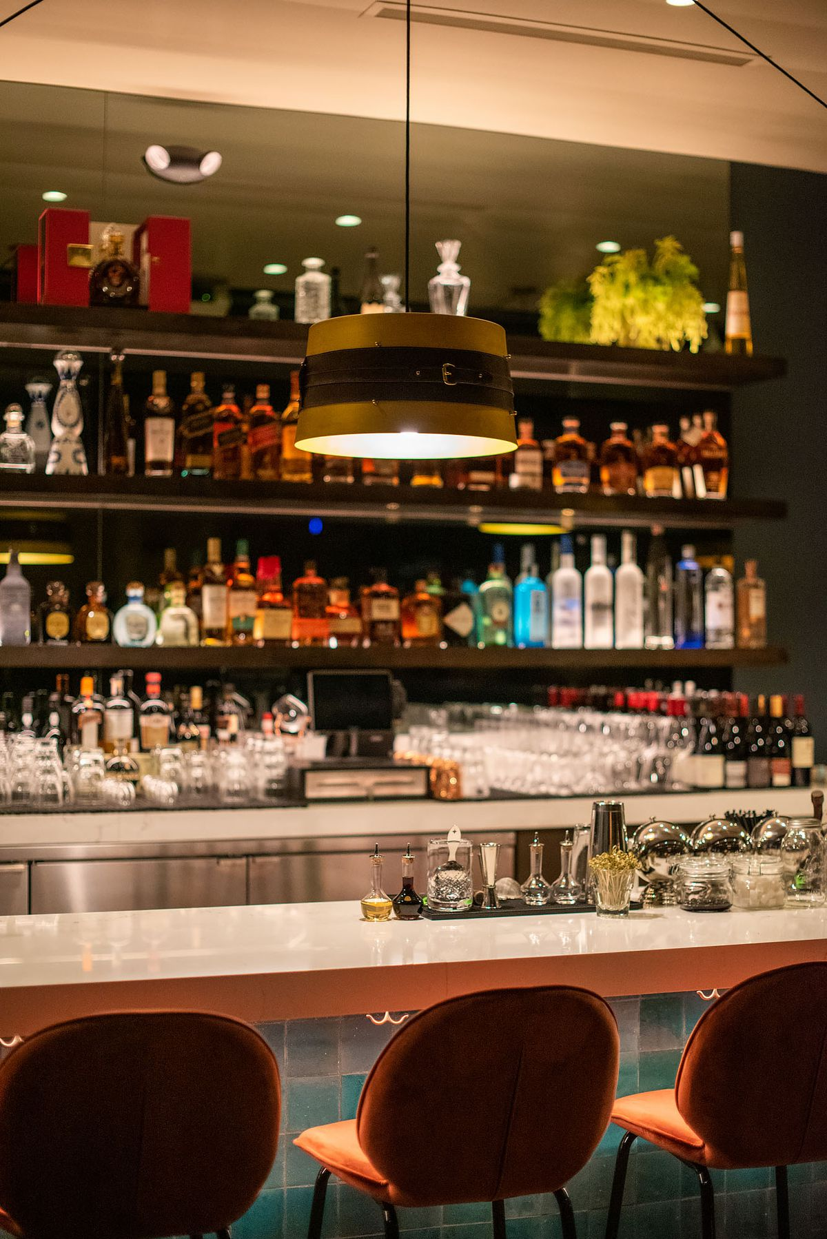 A colorful bar and marble top with luxury seating.