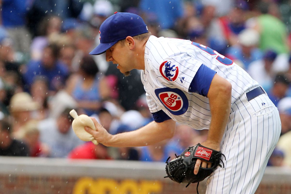 Shawn Camp of the Chicago Cubs dries off his hands during play against the Arizona Diamondbacks at Wrigley Field in Chicago, Illinois. (Photo by Tasos Katopodis /Getty Images)