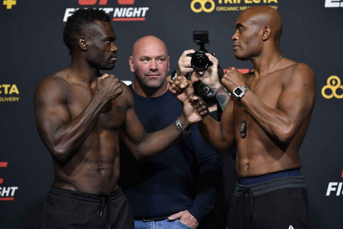 Opponents Uriah Hall of Jamaica and Anderson Silva of Brazil face off during the UFC Fight Night weigh-in at UFC APEX on October 30, 2020 in Las Vegas, Nevada.