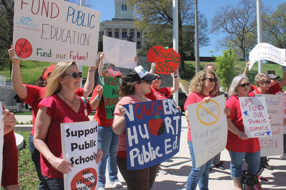 Teachers, parents and other education advocates protest on April 9, 2019, at Tennessee's Capitol, where they voiced concerns about Gov. Bill Lee's education savings account proposal.
