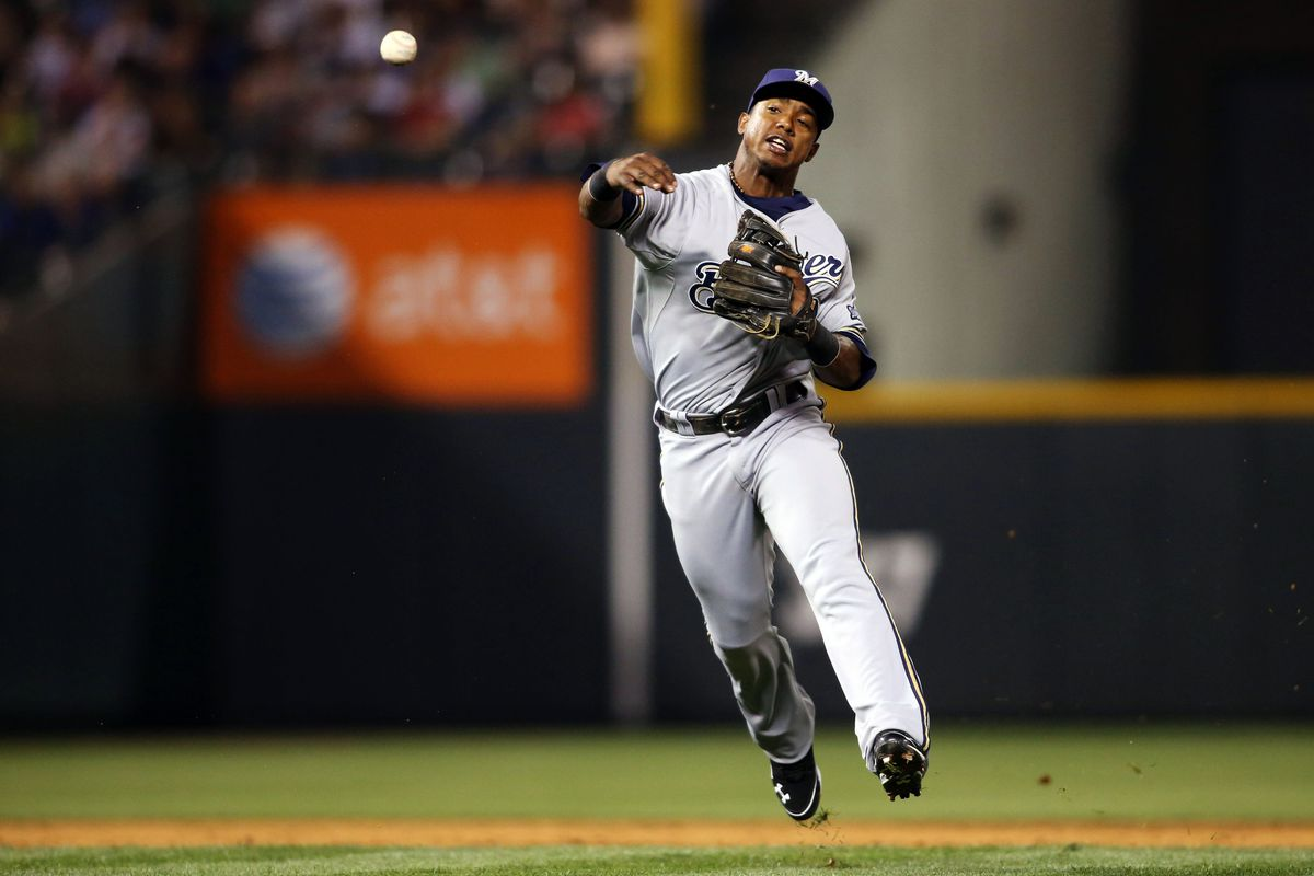 August 14, 2012; Denver, CO, USA; Milwaukee Brewers shortstop Jean Segura (9) fields a ball during the fifth inning against the Colorado Rockies at Coors Field.  Mandatory Credit: Chris Humphreys-US PRESSWIRE