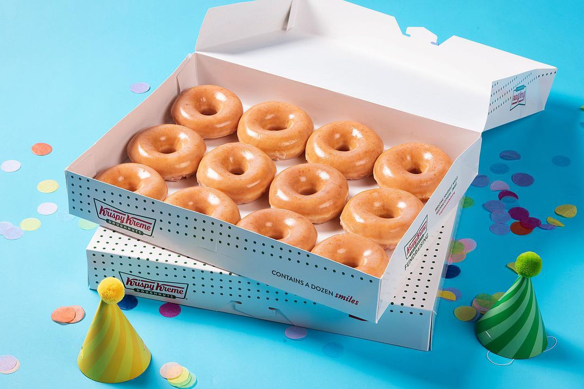 A box of Krispy Kreme donuts on a colorful background.