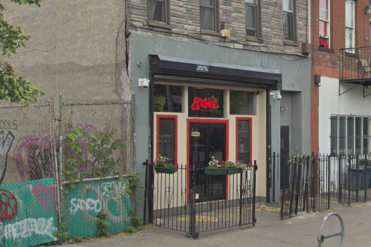The exterior of a restaurant in Brooklyn with the words Archie's in neon red on the front