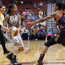 San Antonio Stars' Moriah Jefferson (4) is guarded by Connecticut Sun's Jasmine Thomas (5).