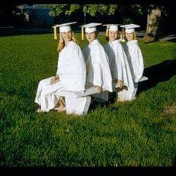 Lorraine Fullmer, Gladys Saxton, Linda Tenney and Lynda Goodman pose for a photo on their Brigham Young High School graduation day in May 1959.
